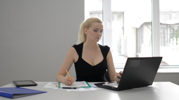 Businesswoman Using Laptop at Work