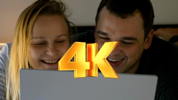 Couple Watching Humorous Video On Laptop