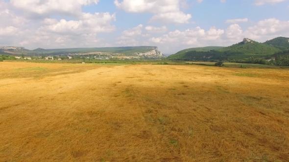 Harvester Combine Working At Golden Field