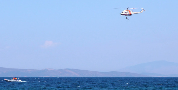 Helicopter is Holding Diver and Sea 2