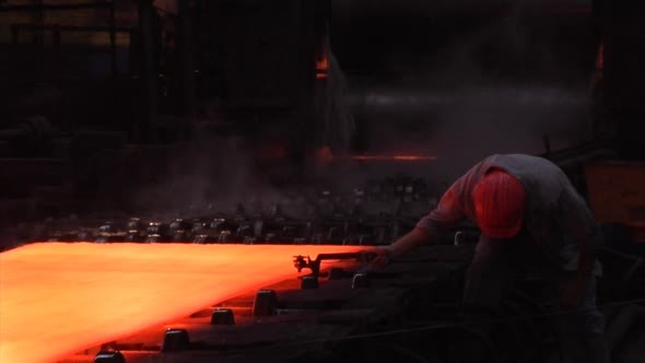 Rolled Sheets of Metal Red Hot Metal Worker