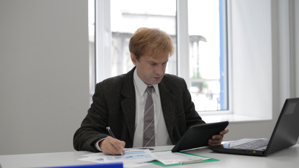 Businessman Using Tablet and Working