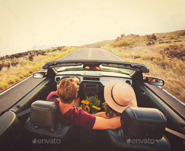 Happy Couple Driving in Convertible - Stock Photo - Images