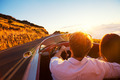 Romantic Couple Driving on Beautiful Road at Sunset - PhotoDune Item for Sale