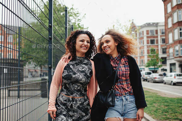 Two young women on the city street - Stock Photo - Images