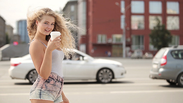 Happy Young Woman With Long Curly Hair Flirting