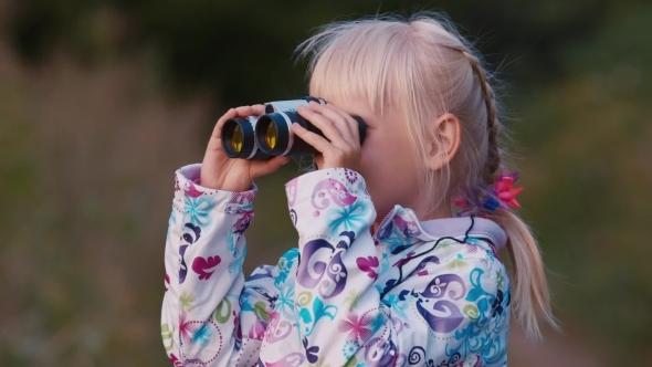 A Girl Looks In Binoculars
