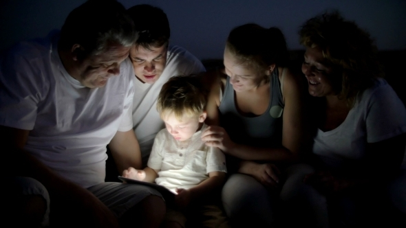 Big Family And Child With Pad Outdoor At Night