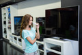 Pretty woman shopping for new television at the electronics store - PhotoDune Item for Sale