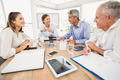 Smiling business people having a meeting in the office - PhotoDune Item for Sale