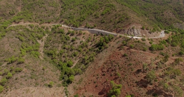 Aerial Flight Over Curvy Road In Mountains