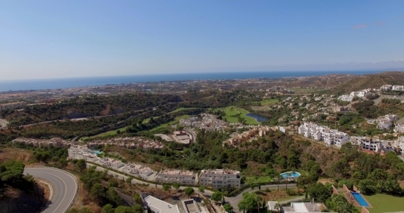 Aerial Flight Over Houses And Golf Fields