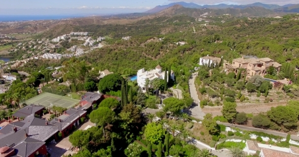 Aerial Flight Over Houses And Trees In Andalucia
