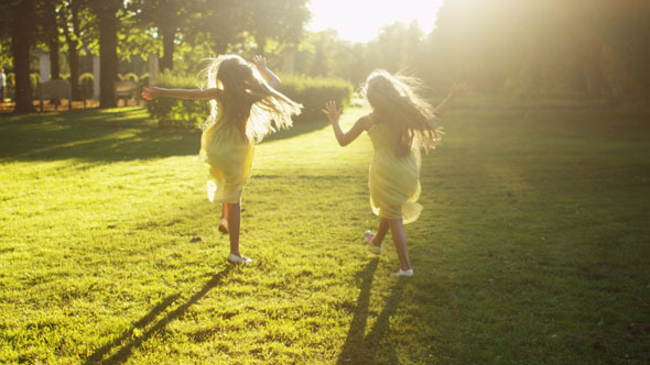 Twin Girls is Running at Park at Sunset Time