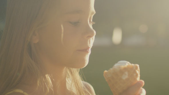 Girl is Eating Ice Cream Outdoors