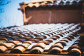 snow on red tiled roof