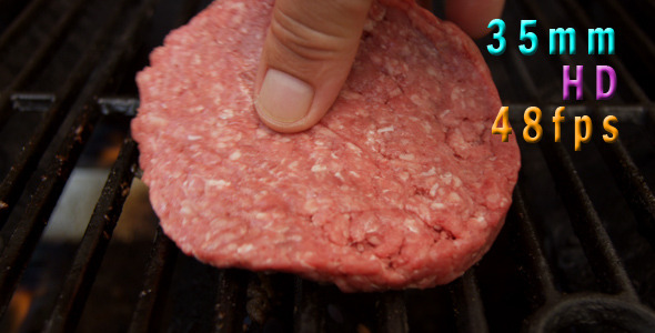 Cooking A Hamburger On Grill 02