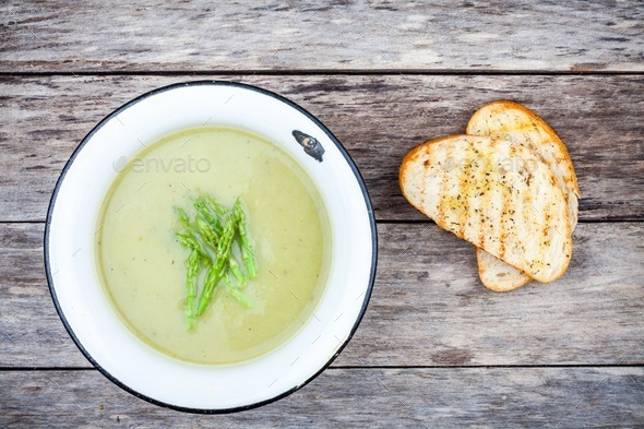 homemade cream soup with asparagus and toasted ciabatta - Stock Photo - Images
