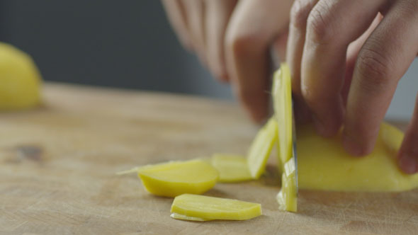 Professional Cook is Rapidly Chopping Potatoes