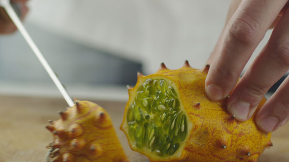 Cook is Slicing Kiwano Melon