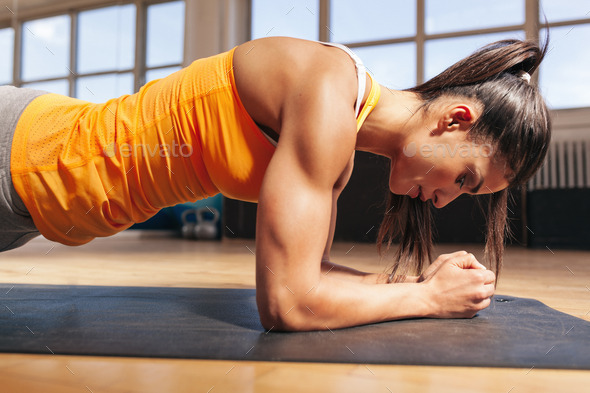 Woman doing press-ups in gym - Stock Photo - Images