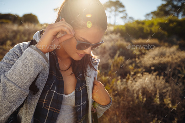 Young woman hiking on a sunny day - Stock Photo - Images