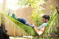 Man using smartphone on hammok - PhotoDune Item for Sale