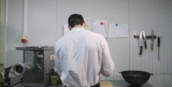 A Cook Prepares in the Kitchen