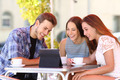 Three friends watching tv or social media in a tablet - PhotoDune Item for Sale