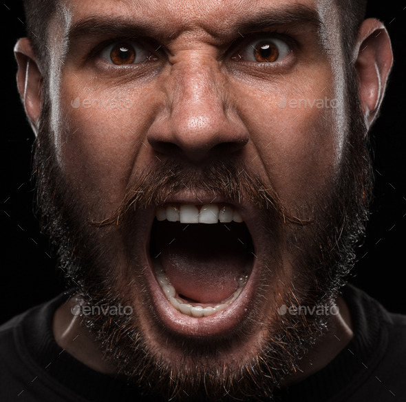Close-up portrait of angry man - Stock Photo - Images