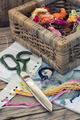 Yarn and thread for embroidering on cloth by hand on wooden surface