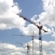 Cranes Working On Construction Site Under Cloudy - VideoHive Item for Sale
