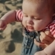 Mother Playing With Her Baby On The Beach - VideoHive Item for Sale