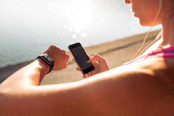 Sportswoman using smart devices - Stock Photo - Images