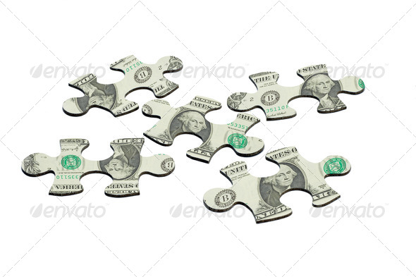 Jigsaw puzzles and US dollar note - Stock Photo - Images