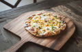 Pizza on a Wooden Board - PhotoDune Item for Sale