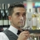 Sommelier With Red Wine And Smelling It - VideoHive Item for Sale