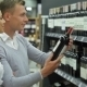 Couple Selecting Wine In Supermarket - VideoHive Item for Sale