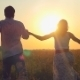 Fashionable Happy Couple Join Hands Runs Across - VideoHive Item for Sale