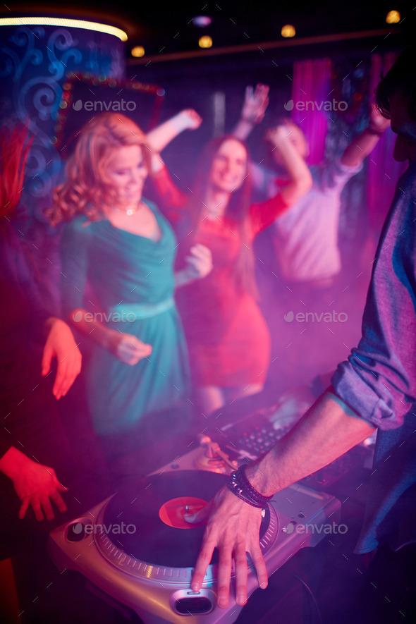 Hand of dj on vinyl disc - Stock Photo - Images