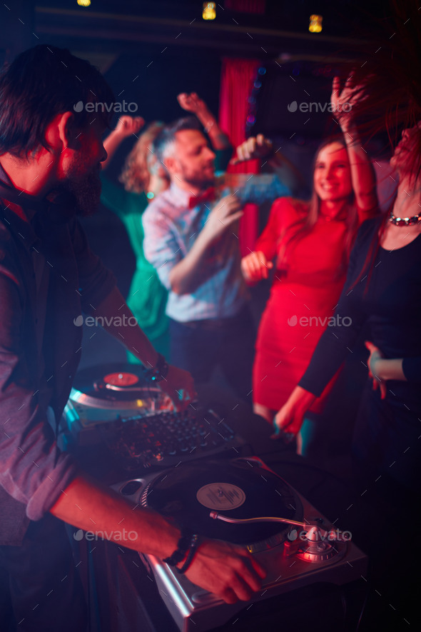 Deejay by turntables - Stock Photo - Images