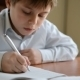 Child Writes Homework - VideoHive Item for Sale
