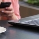 Girl Using Her Mobile Phone In Cafe - VideoHive Item for Sale