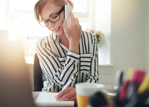Successful self-employed young woman - Stock Photo - Images