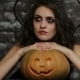 The Woman-sorceress Posing With Pumpkin - VideoHive Item for Sale