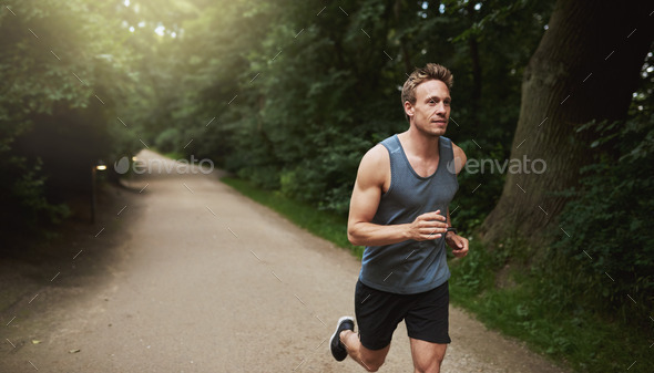 Athletic Man Doing Running Exercise at the Park - Stock Photo - Images