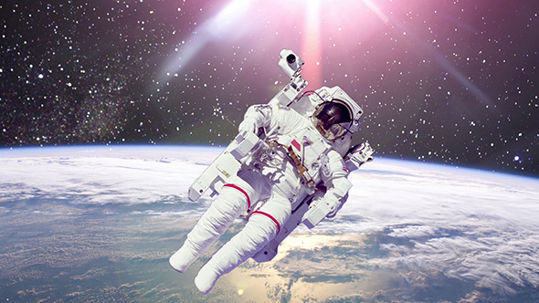Astronaut In Outer Space Against Of Planet Earth