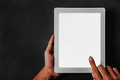 hands holding and touching the screen of tablet with white blank