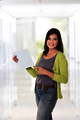 Beautiful asian woman holding a digital touch screen tablet