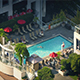 People Enjoying Swimming Pool In Apartment Complex - VideoHive Item for Sale